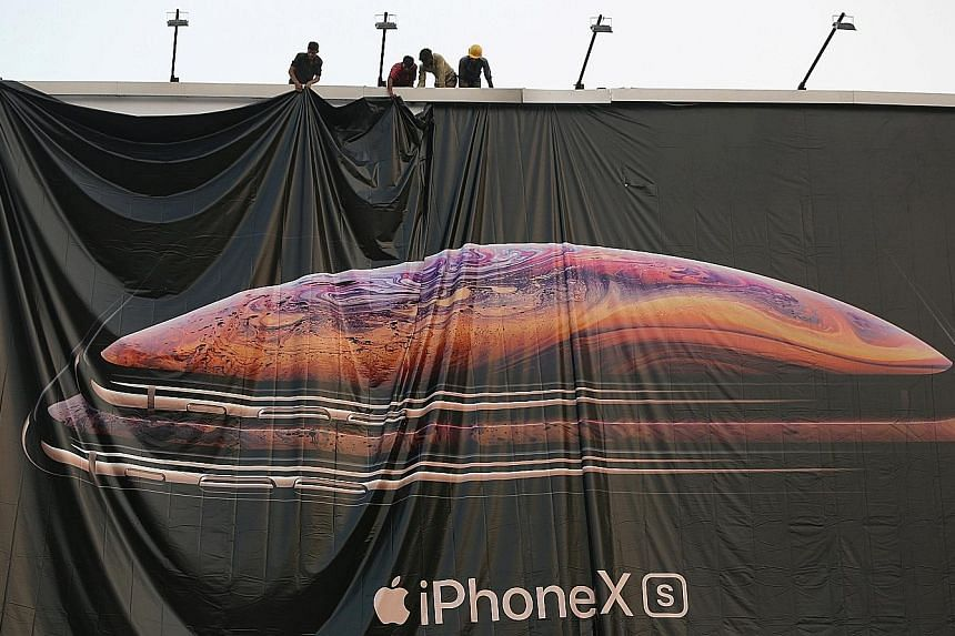 Workers adjusting the iPhone XS advertisement in India. Taiwanese contract manufacturer Foxconn will be assembling the most expensive models, such as devices in the iPhone X family in its plant in the Southern state of Tamil Nadu.