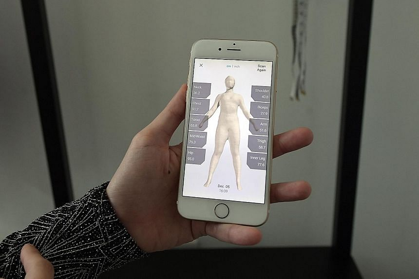 (Left) The 2m-tall scanner from Taiwan has sensors in its frame to capture a 3D image of a customer's body. (Right) The scanner is linked to a phone app and the measurements are sent to the tailor's phone with the 3D image, which can be spun around s