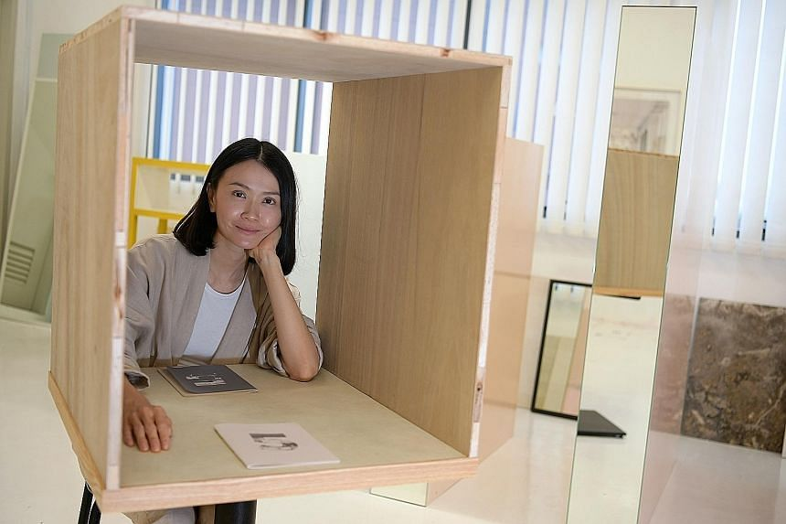 """Titled 11, the performance artwork by artist Dawn Ng (left) sees members of the public reading from prepared scripts to one another in """"confessional booths""""."""
