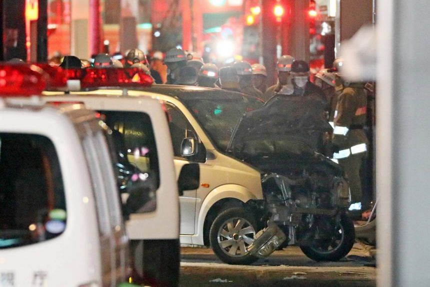 Rescue services and police officers standing behind a car that ploughed into a crowd in Harajuku in Tokyo, early on Jan 1, 2019.