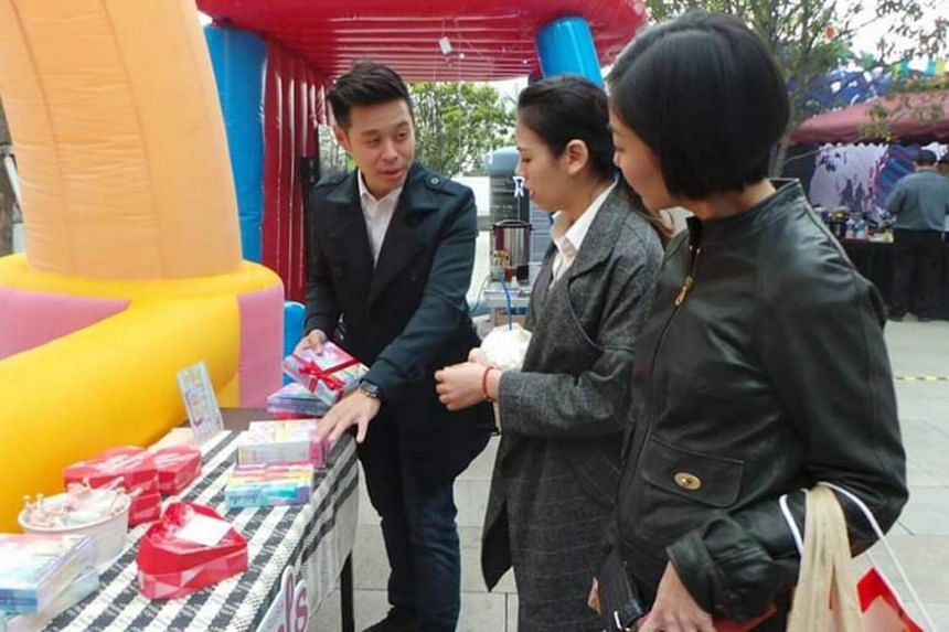Chinese customers sampling food from Singapore brands at an exhibition in China.