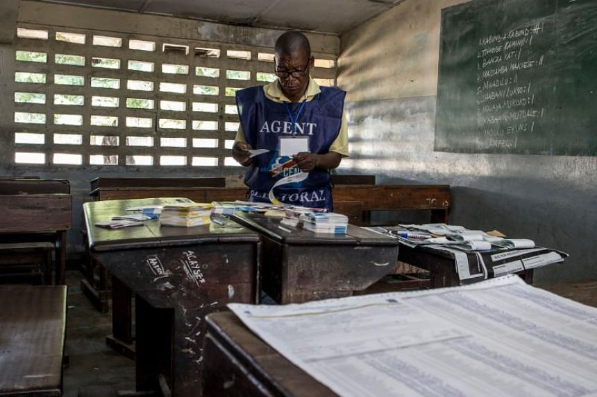 An electoral agent arranges ballots at a polling station in Kinshasa, on December 31, 2018 the morning after the presidential elections.