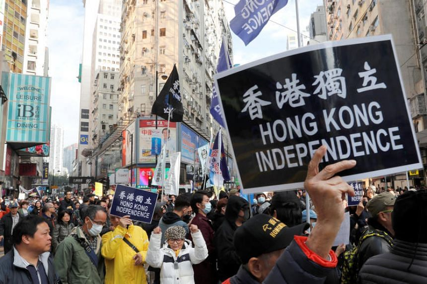 Pro-independence supporters take part in an annual New Year's Day march in Hong Kong on Jan 1, 2019.