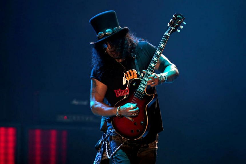 Slash, lead guitarist of rock band Guns N' Roses, performs during their Not in This Lifetime... Tour at the du Arena in Abu Dhabi, United Arab Emirates on Nov 25, 2018.