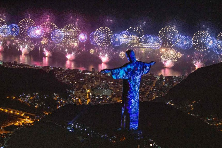 A view of Christ the Redeemer above Rio De Janeiro during the new year fireworks celebration, on Jan 1, 2019.