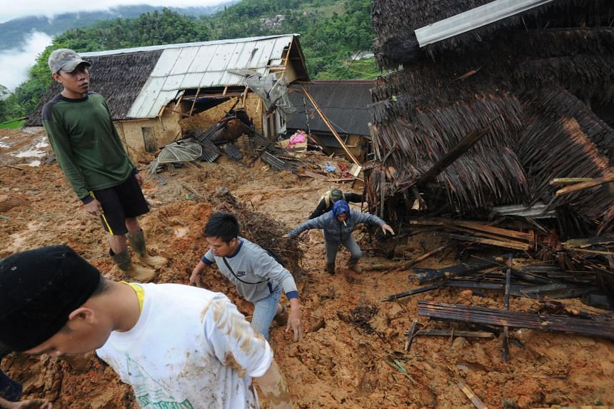 Villagers and rescuers search for landslide victims at Sirnaresmi village in Sukabumi, Indonesia, on Jan 1, 2019.