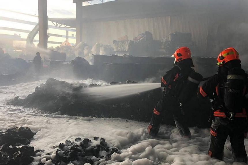 The fire involved plastic waste and tyres, and was found to be burning strongly when SCDF arrived.