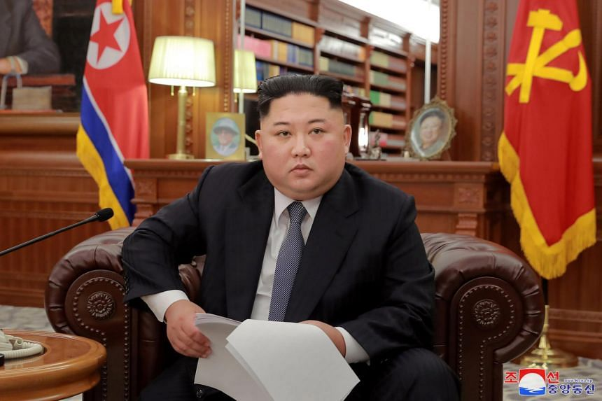 North Korean leader Kim Jong Un in a Jan 1, 2019 photo by the country's Korean Central News Agency. The setting is a departure from more formal past addresses.