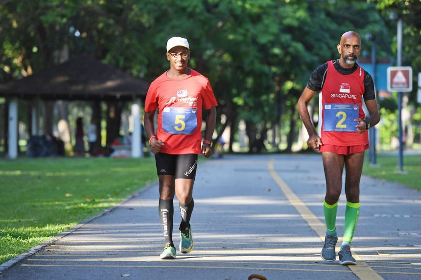 Veteran walkers R. Subramaniam and G. Suresh Kumar (with cap) on the last 40km of their 200km bicentennial walk yesterday. Eight walkers started the attempt last Saturday but six dropped out along the way.