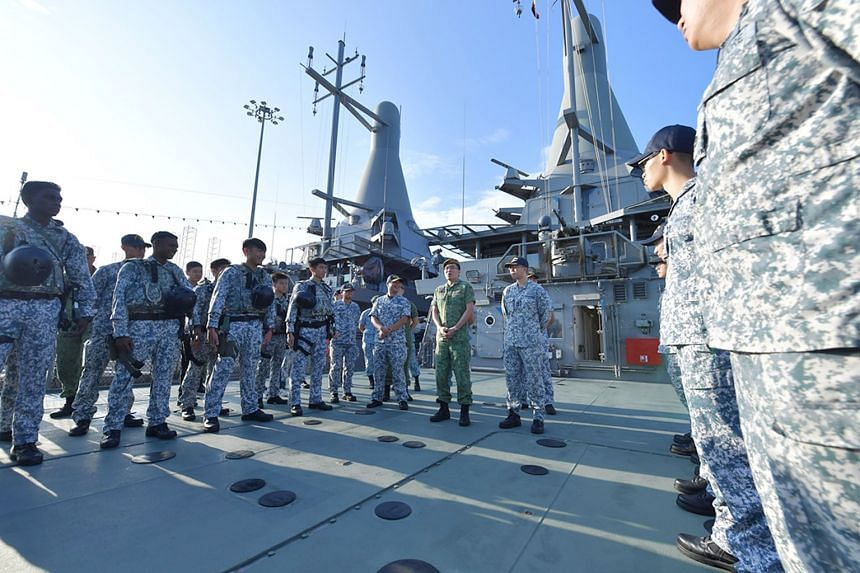Above: Chief of Defence Force Melvyn Ong addressing the crew of the Republic of Singapore Navy's littoral mission vessel RSS Justice and members of the Accompanying Sea Security Team at Tuas Naval Base yesterday.