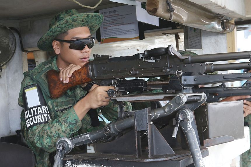 Above: An army security trooper on watch with a GPMG, or general-purpose machine gun.