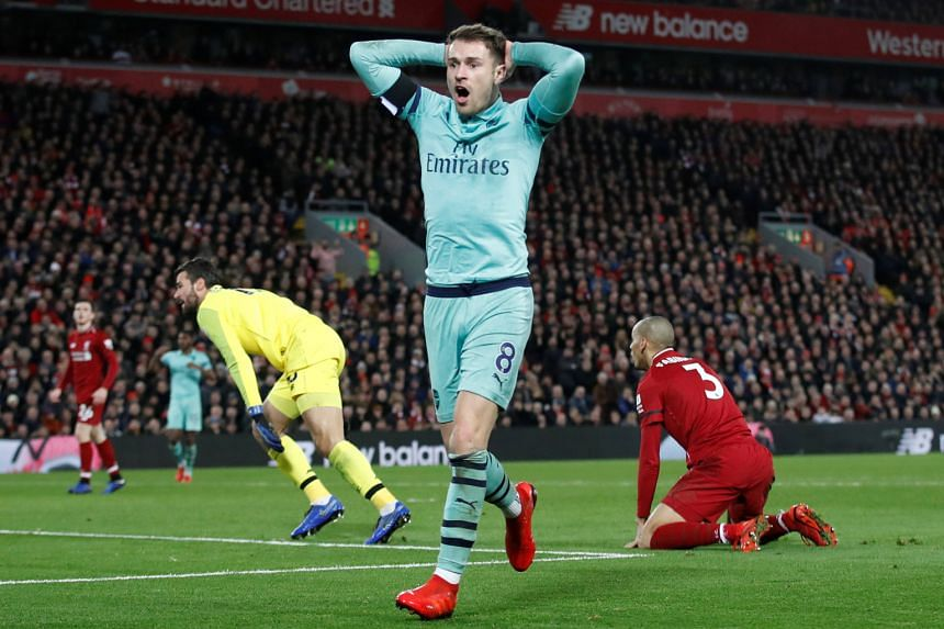 A flustered Aaron Ramsey after missing another chance for Arsenal in their 5-1 thrashing by Liverpool at Anfield on Saturday. The Gunners, who have leaked 30 league goals so far, must beat second-last Fulham today at home to revive their Champions Le