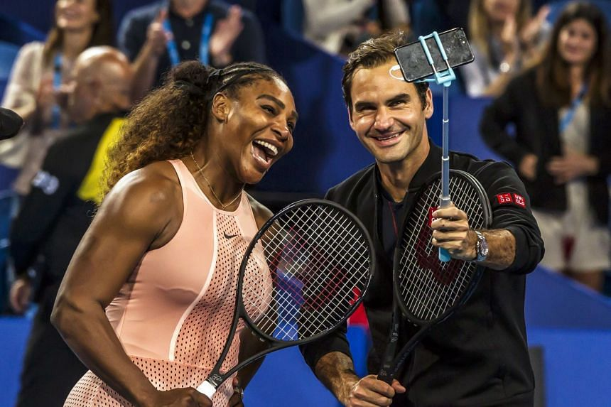Williams and Federer take a selfie after their mixed doubles match on day four of the Hopman Cup.