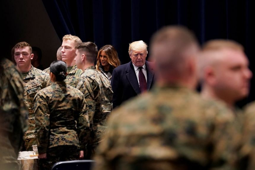 US President Donald Trump and First Lady Melania Trump visiting the Marine Corps Barracks in Washington in November 2018.