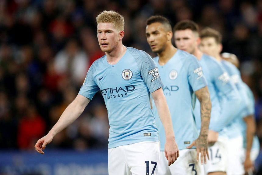Manchester City's Kevin De Bruyne and team mates.