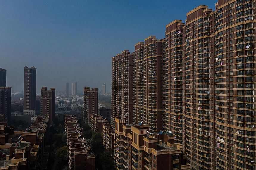 The Yudong International complex in Jurong, China. A glut of apartments across the country is partly blamed for a slowdown in the world's second-largest economy - and, by extension, dragging down growth around the world. In some places, home owners a