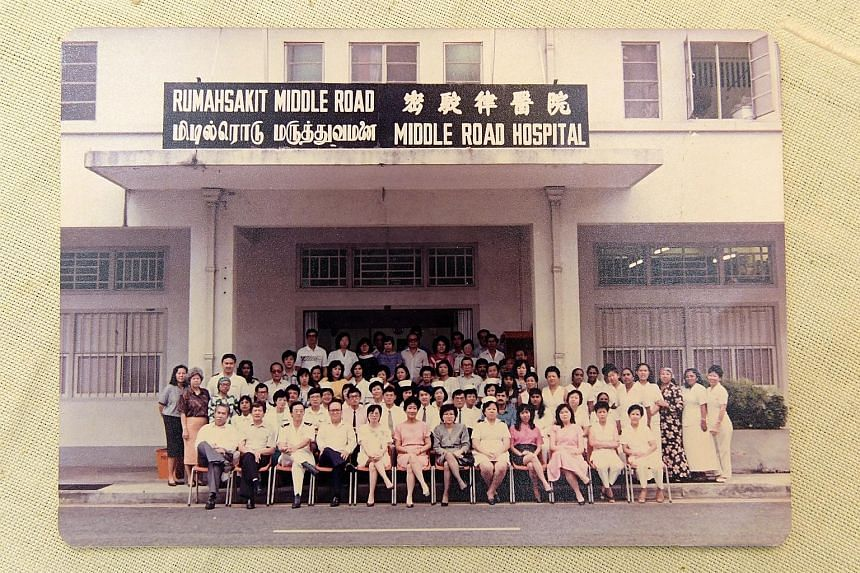 Above: Mrs Verghese (top row, fourth from left, in purple) with her Middle Road Hospital colleagues. The hospital was designated to handle Aids cases at the time. Above, left: Mrs Verghese outside the venue for an international Aids conference in Dur