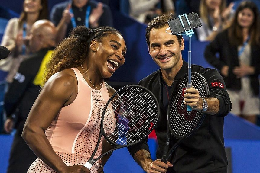 Tennis greats Serena Williams and Roger Federer taking a wefie after their Hopman Cup mixed doubles match yesterday.