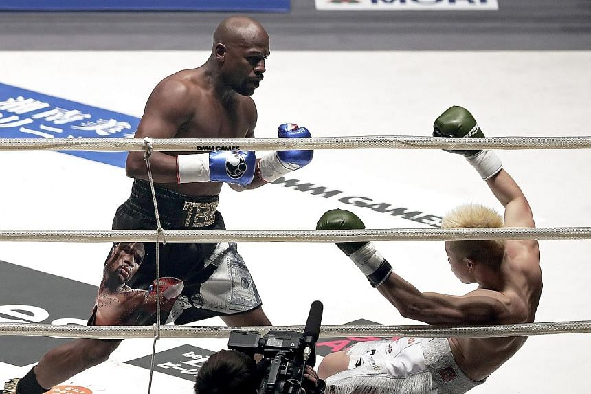 Retired American boxer Floyd Mayweather sending his Japanese kickboxing opponent Tenshin Nasukawa sprawling to the canvas during their exhibition bout in Tokyo on Monday.