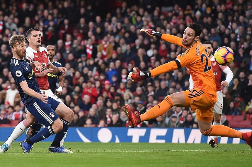 Arsenal midfielder Granit Xhaka stabbing the ball past Fulham goalkeeper Sergio Rico from close range to open accounts in a 4-1 English Premier League win at the Emirates Stadium in London yesterday. The visitors could have taken the lead in the firs