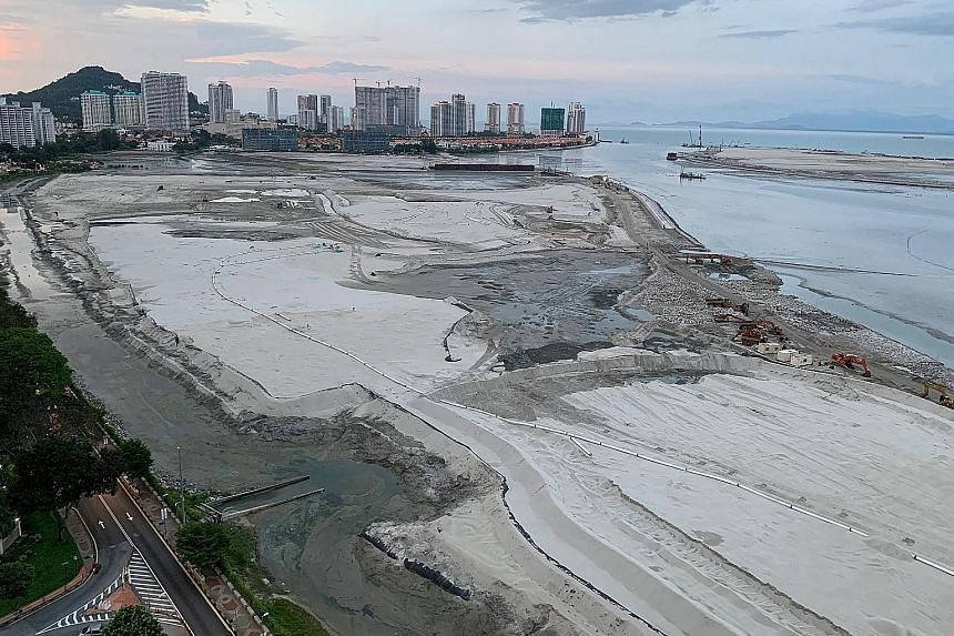Land reclamation at Penang's famous Gurney Drive beachfront (above). To finance the transport masterplan, the state government is proposing to reclaim land to build three islands for development on Penang's south coast totalling 1,738ha, nearly four