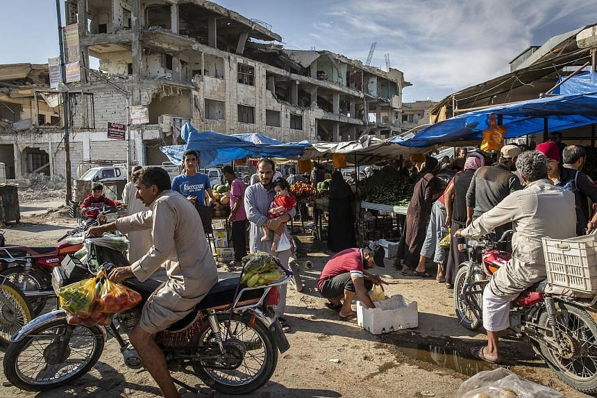 A market in Raqqa, Syria. US military planners say they need about 120 days, or four months, to carry out an orderly withdrawal of 2,000 troops from Syria. Military officials have scrambled to translate President Donald Trump's shifting directives an