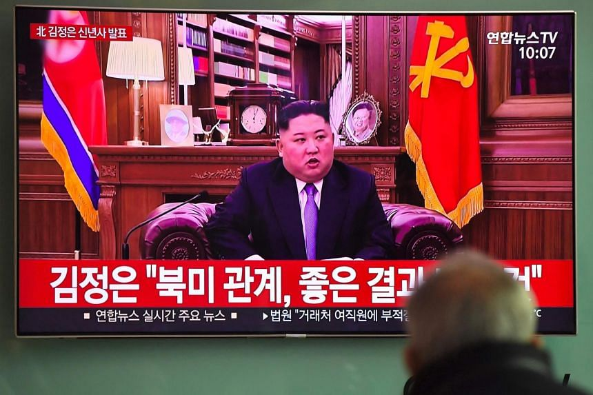 A man watches a television screen showing North Korean leader Kim Jong Un's speech at a railway station in Seoul, on Jan 1, 2019.