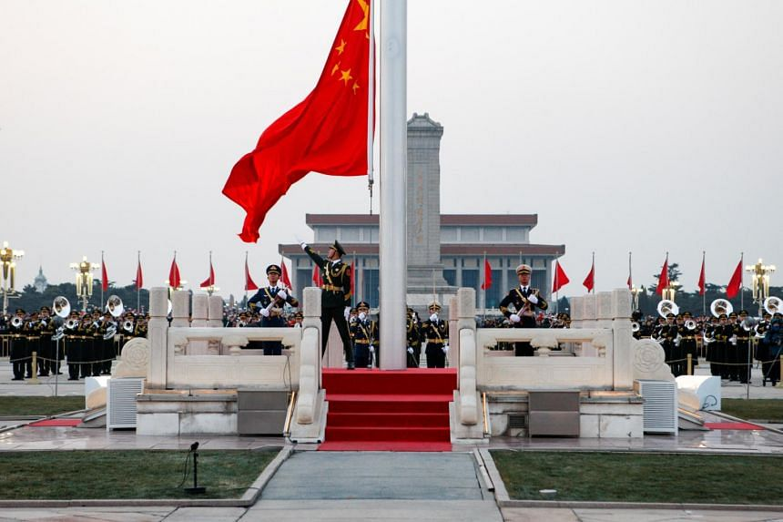 Soldiers of the Chinese People's Liberation Army take part in a flag-raising ceremony to mark the new year on Tiananmen Square in Beijing, China, on Jan 1, 2019.