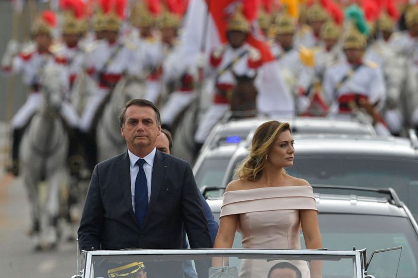 Bolsonaro and his wife Michelle head to the National Congress in Brasilia for his swearing-in ceremony.