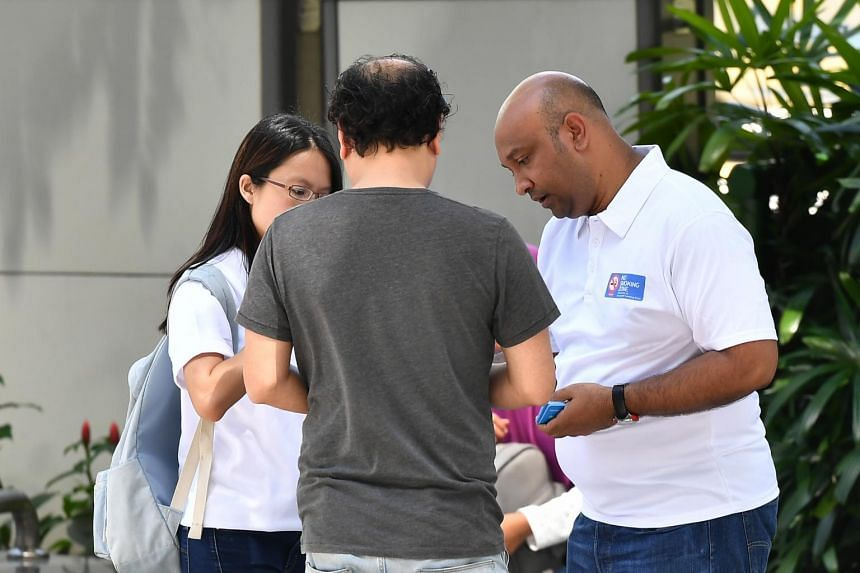 Enforcement officers from the National Environment Agency, dressed in white No Smoking Zone polo T-shirts, were on patrol in Orchard Road on the first day of the new year, nabbing smokers in the new prohibited areas.