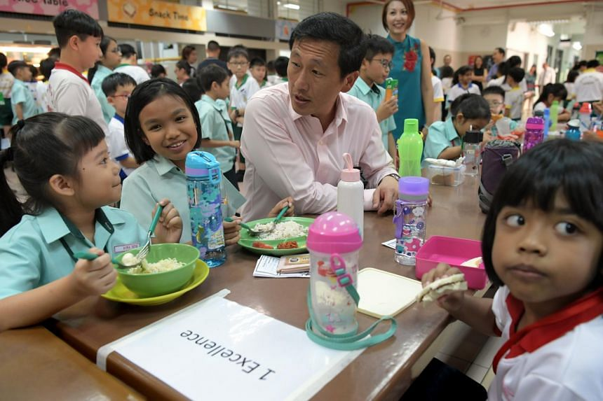 Education Minister Ong Ye Kung with Primary 1 pupils at Huamin Primary School on Jan 2, 2019. Mr Ong had said that for every exam cut, teachers will get about three more weeks for curriculum time.