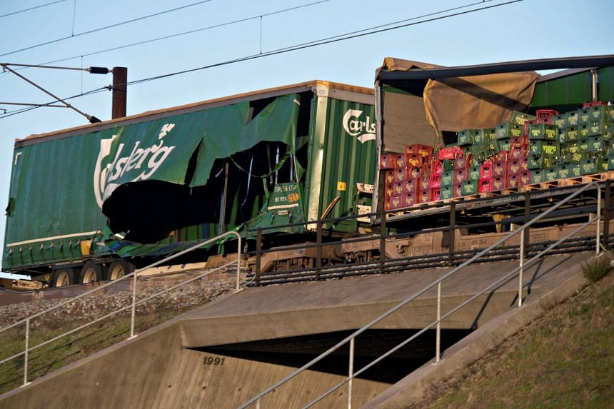 The passenger train, heading towards Copenhagen, was hit by objects from a freight train.