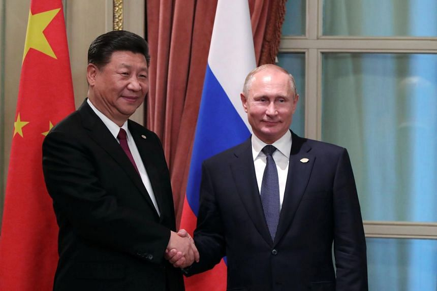 China's President Xi Jinping (left) and Russian counterpart Vladimir Putin shaking hands during a bilateral meeting on the sidelines of the G20 Summit in Buenos Aires, Argentina, on Nov 30, 2018.