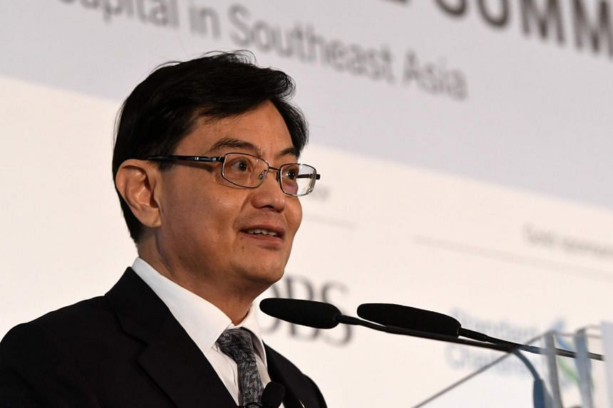 Singapore finance minister Heng Swee Keat delivers a keynote address at the 8th World Bank-Singapore infrastructure Finance Summit in Singapore on April 5, 2018.