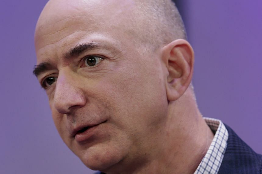 Amazon chief executive Jeff Bezos (top) was last year's biggest gainer, with his net worth growing US$24 billion to US$123 billion, while Facebook founder and CEO Mark Zuckerberg's (above) net worth fell nearly US$20 billion.