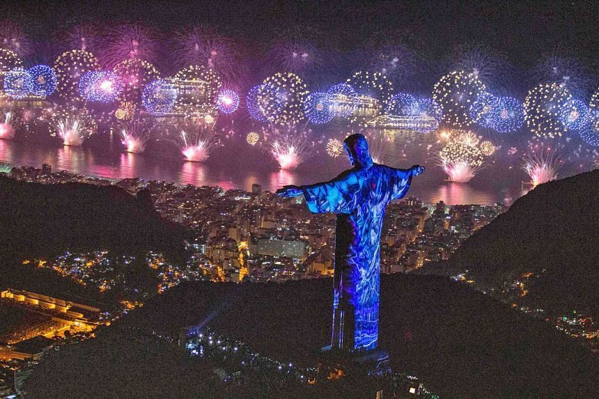 Rio de Janeiro's famed hilltop Christ the Redeemer statue coming to life in 3D colour during the fireworks spectacle.