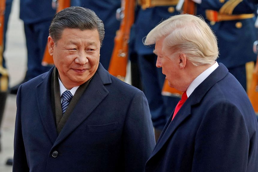 US President Donald Trump with Chinese President Xi Jinping during a visit to Beijing in 2017. In his congratulatory message to Mr Xi yesterday, Mr Trump said it was his priority to promote cooperative and constructive US-China relations. The two lea