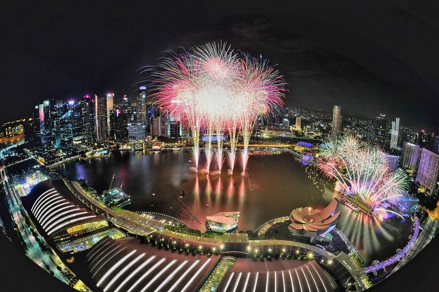 The Marina Bay area lit up with fireworks, as seen from Marina Bay Sands SkyPark, to welcome 2019. More than 500,000 revellers thronged the bay area and Civic District to catch the festivities, which included carnival rides, games and live performanc
