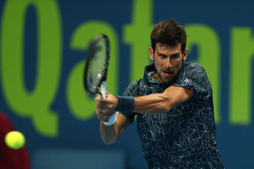 Djokovic returns the ball to Bosnia and Herzegovina's Damir Dzumhur.