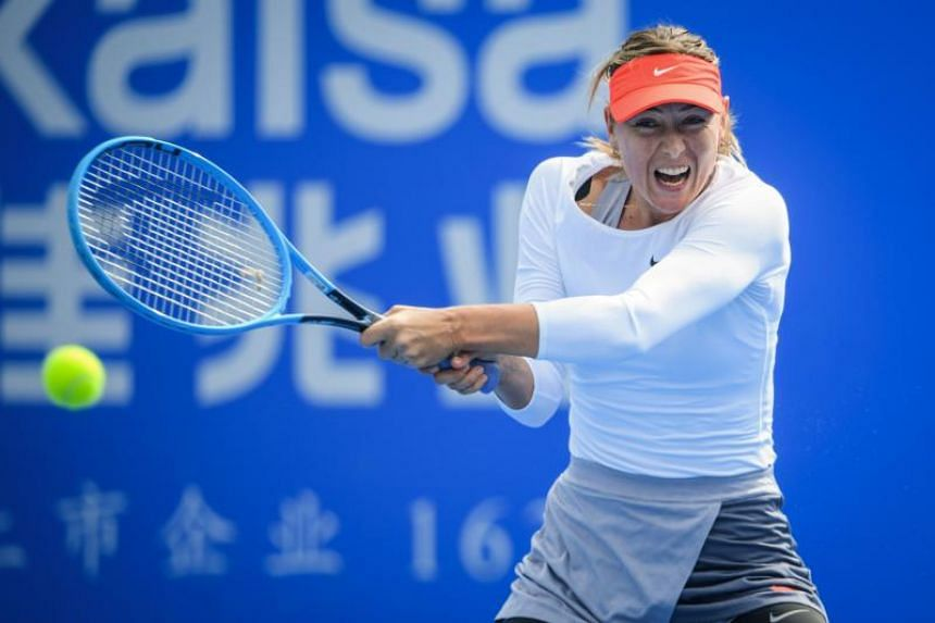 Maria Sharapova of Russia hits a return against Wang Xinyu of China (not pictured) during their women's singles second round match at the Shenzhen Open tennis tournament in Shenzhen in China's southern Guangdong province on Jan 2, 2019.