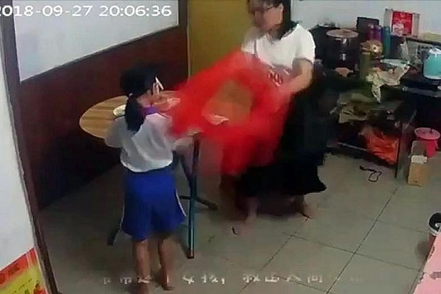 An online video clip showing the eight-year-old girl being beaten repeatedly by her mother in Shenzhen last September. The parents have since been arrested and are facing criminal penalties.