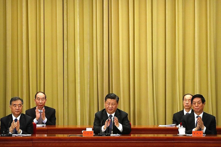 Chinese President Xi Jinping (centre) at an event yesterday to mark 40 years since China proposed ending military confrontation with Taiwan and seeking reunification through dialogue, at the Great Hall of the People in Beijing.