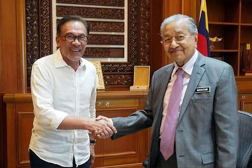 """Datuk Seri Anwar Ibrahim (left) and Prime Minister Mahathir Mohamad met for an hour yesterday. Mr Anwar tweeted that they agreed on """"the same strategies regarding Singapore"""""""
