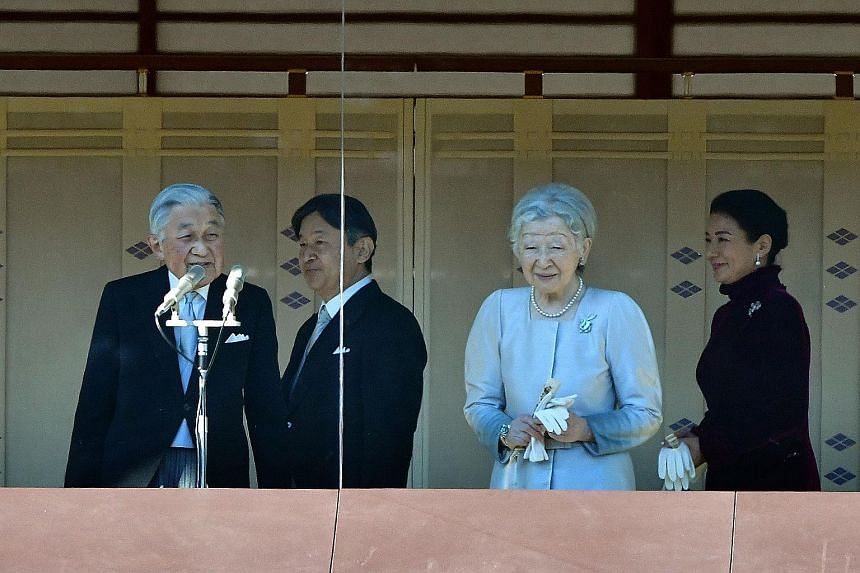 Members of the public queuing to enter the Imperial Palace for the traditional New Year appearance by the royal family yesterday. About 154,800 people flocked to the palace for a chance to see the 85-year-old monarch.