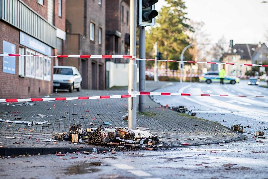 Police cordoned off the area in Bottrop where several people were injured after a man drove into a group of revellers on New Year's Eve.
