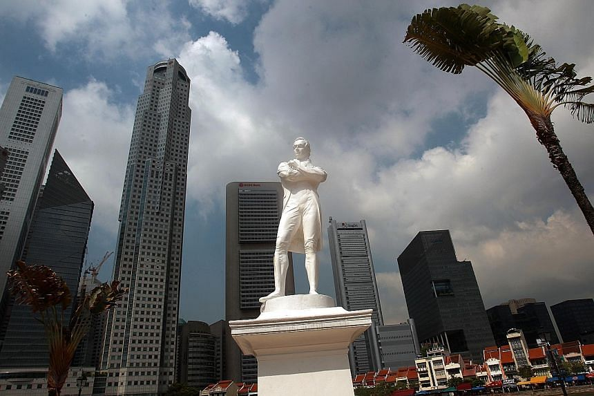 The white, polymarble statue of Sir Stamford Raffles by the Singapore River (left) has been partially painted over to blend in with the OCBC Centre building across the water (below left).