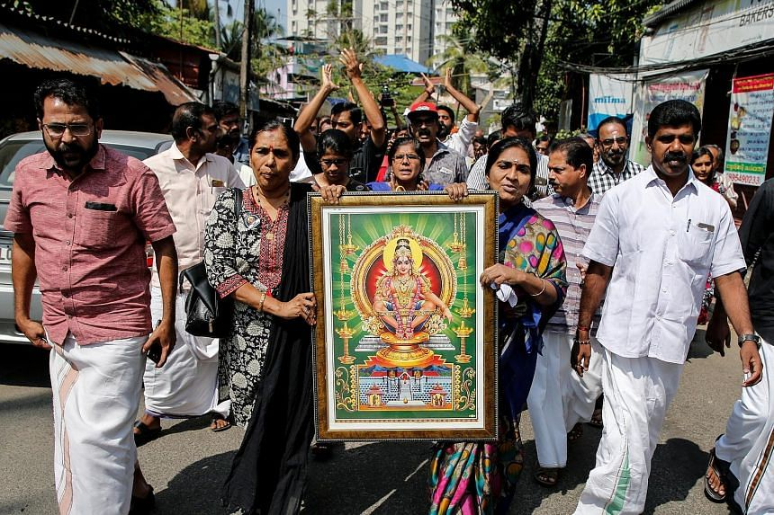 Protesters carrying a portrait of the deity Lord Ayyappa during a rally yesterday called by various Hindu organisations after the two women entered the Sabarimala temple in Kochi, Kerala. Women between the ages of 10 and 50 were banned out of traditi