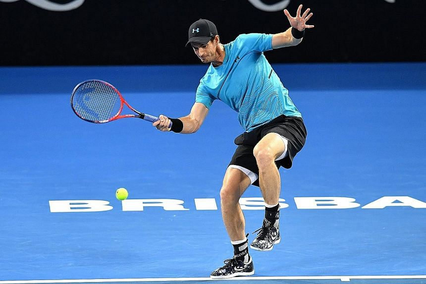 Andy Murray attempting to hit a return during his second-round match against Daniil Medvedev at the Queensland Tennis Centre in Brisbane yesterday. The Russian won in straight sets.