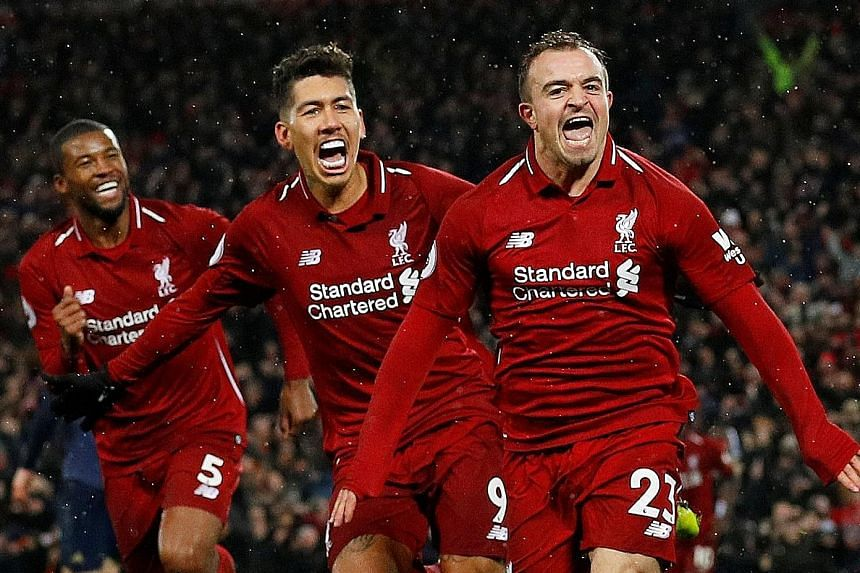 Liverpool's Xherdan Shaqiri (right) celebrating his second goal with Roberto Firmino and Georginio Wijnaldum in the 3-1 Premier League home win over Manchester United on Dec 16.