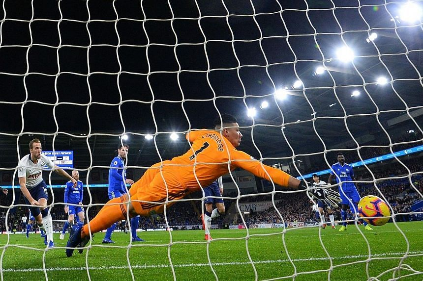 Cardiff City goalkeeper Neil Etheridge is beaten just three minutes into their Premier League home match against Tottenham. Striker Harry Kane got lucky when a clearance hit his leg and rebounded into goal.